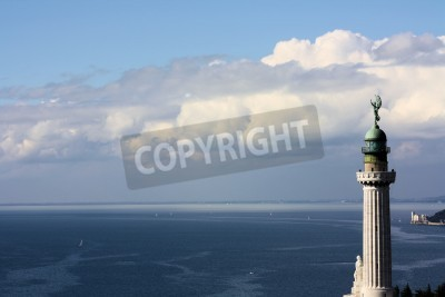 Lighthouse with sea blue with a white castle