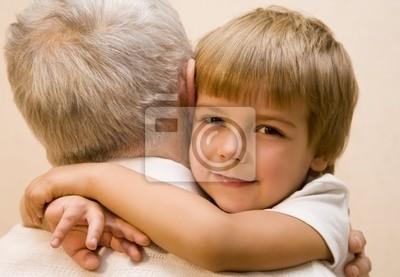 Canvas print Little boy embrace his grandpa