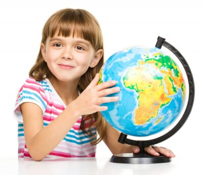 Canvas print Little girl is examining globe