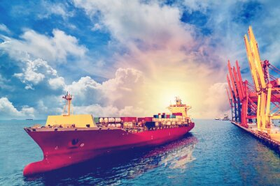 Canvas print Logistics and transportation of International Container Cargo ship with ports crane bridge in harbor for logistic import export background and transport industry.. Vintage color.