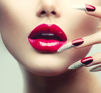 Canvas print Makeup and Manicure. Red Long Nails and Red Glossy Lips