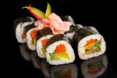 Canvas print Maki sushi served on black background