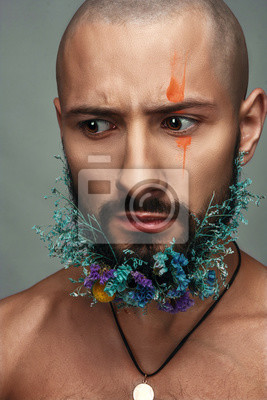 Canvas print Man with creative makeup and flowers in his beard