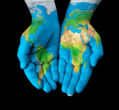 Canvas print Map painted on hands showing concept - the world in our hands