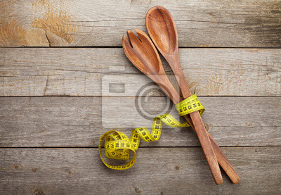 Canvas print Measure tape with kitchen utensils. Diet food