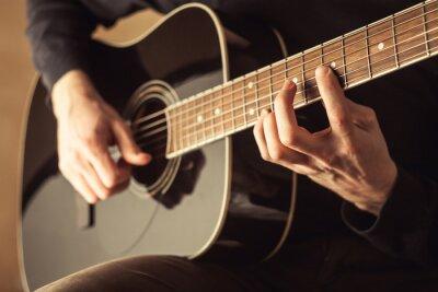 Canvas print Men playing guitar close-up shot