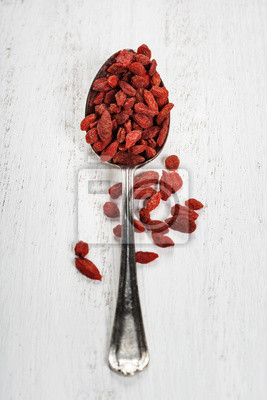 Canvas print Metal tablespoon of dried goji berries
