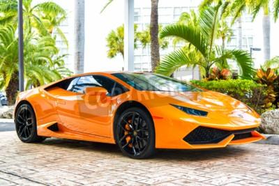 Canvas print Miami, Florida, USA-February 19, 2016: Supercar Lamborghini Aventador orange color parked next to Ocean drive at South bech at Miami, Florida. Lamborghini is famous expensive automobile brand car