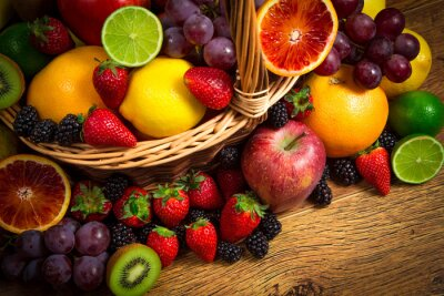 Canvas print Mix of fresh fruits on wicker bascket