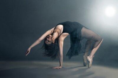 Canvas print Modern style dancer posing on grey background