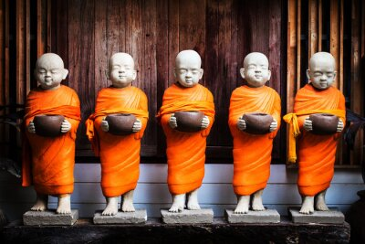 Canvas print Monk statue holding bowl