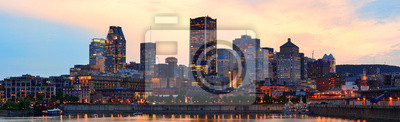 Canvas print Montreal over river at dusk