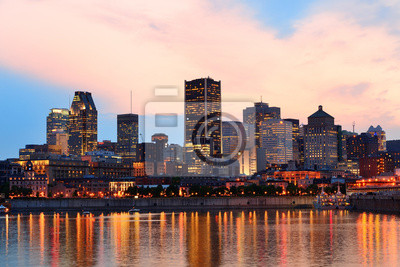 Canvas print Montreal over river at sunset