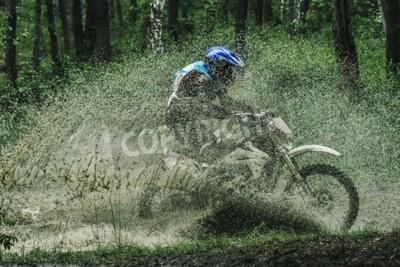 Canvas print Motocross bike crossing creek, water splashing  in competition