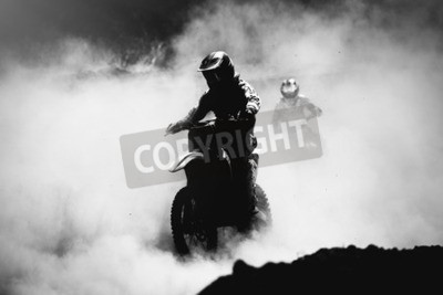 Canvas print Motocross racer accelerating in dust track, Black and white, high contrast photo