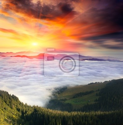 Mountain landscape with cloudy sky and sun