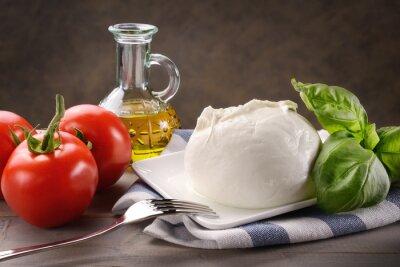 Canvas print Mozzarella di bufala con pomodori, basilico e olio extravergine