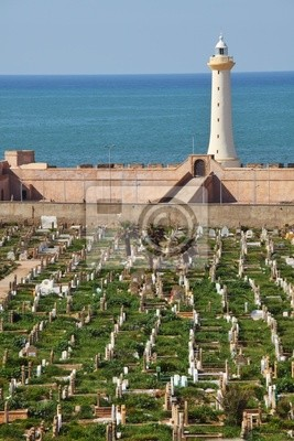 Muslim cemetery with lighthouse and sea background
