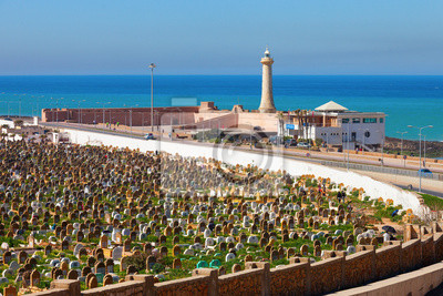 Muslim cemetery - with the lighthouse on sea coast background -