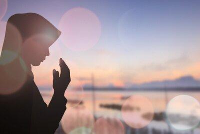 Canvas print Muslim Woman pray and Beautiful background..
