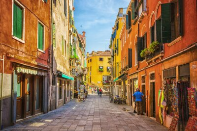 Canvas print Narrow canal among old colorful brick houses in Venice
