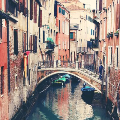 Canvas print Narrow canal and bridge in Venice, Italy