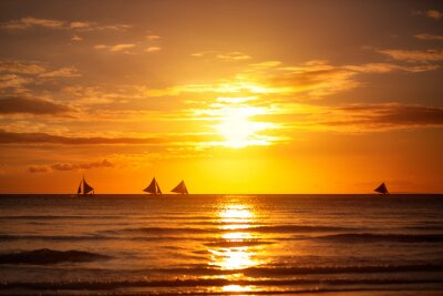Nature background, beautiful sunset on sea with sailboat