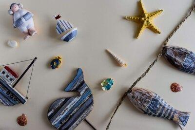 Nautical life style items: sea shells, fish, rope, lifebuoy. Marine concept.
