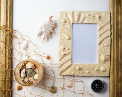 Nautical life style items: sea shells, rope and old empty photo for the inside. Marine concept.