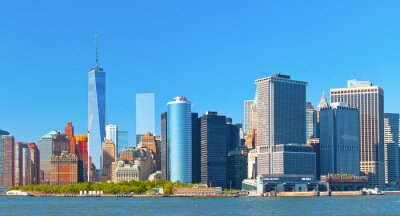 Canvas print New York City lower Manhattan financial  wall street district buildings skyline on a beautiful summer day with blue sky