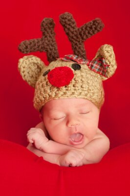 Canvas print Newborn Baby Wearing a Red-Nosed Reindeer Hat