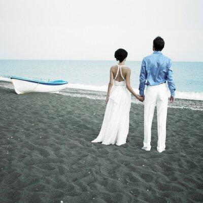 Canvas print Newlyweds at the sea
