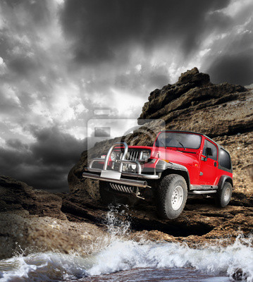 Canvas print Offroad vehicle on the mountain terrain