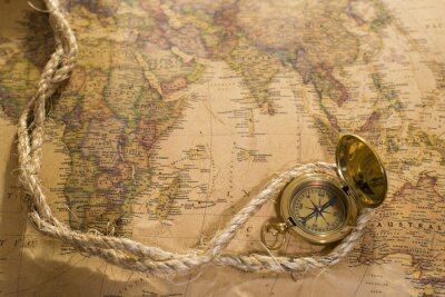 Canvas print old compass and rope on vintage map