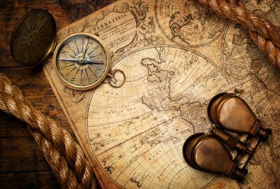 Canvas print old compass, binoculars and rope on vintage map