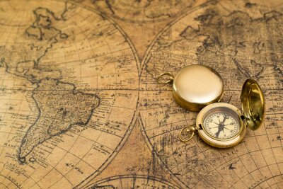 Canvas print old compass on vintage map