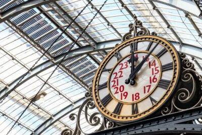 Canvas print Old-fashioned style clock at Kings Cross train station in London