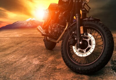 Canvas print old retro motorcycle and beautiful sunset sky background
