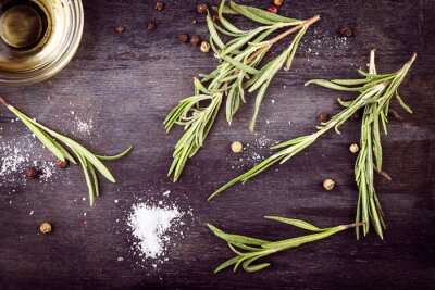 Canvas print Olive oil with  rosemary, pepper and salt. Mediterranean ingredients.