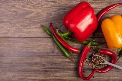 Canvas print On top view of chili, sweet pepper and spicy pepper