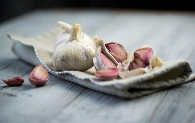 Canvas print Organic garlic on wooden background