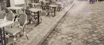 Canvas print Outdoor restaurant tables in Paris, vintage view
