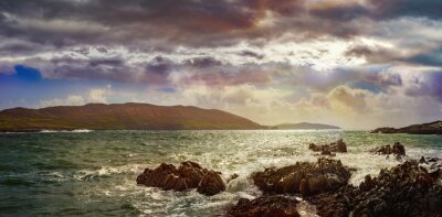 Panoramic evening landscape with cloudy sky and rocks in County Cork