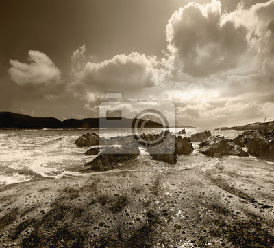 Panoramic evening landscape with cloudy sky and rocks in County Cork. Allihies.