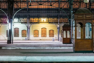 Canvas print Passenger platform at night on the railway station. Train station at night.