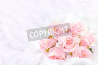 Canvas print Pastel Coloured Artificial Pink Rose Wedding Bridal Bouquet on white fur background with soft vintage tone
