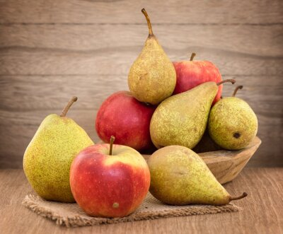 Canvas print Pears and apples on wood table