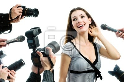 Photograthers are taking a picture of a film star