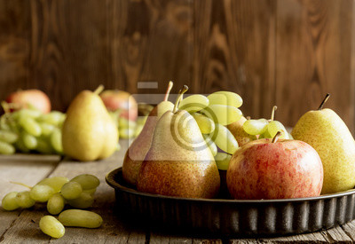 Plate with pears and apples. Autumn fruits. Horizontall photo.