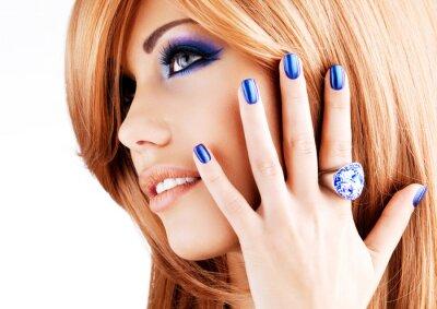 Canvas print portrait of a beautiful woman with blue nails, blue makeup